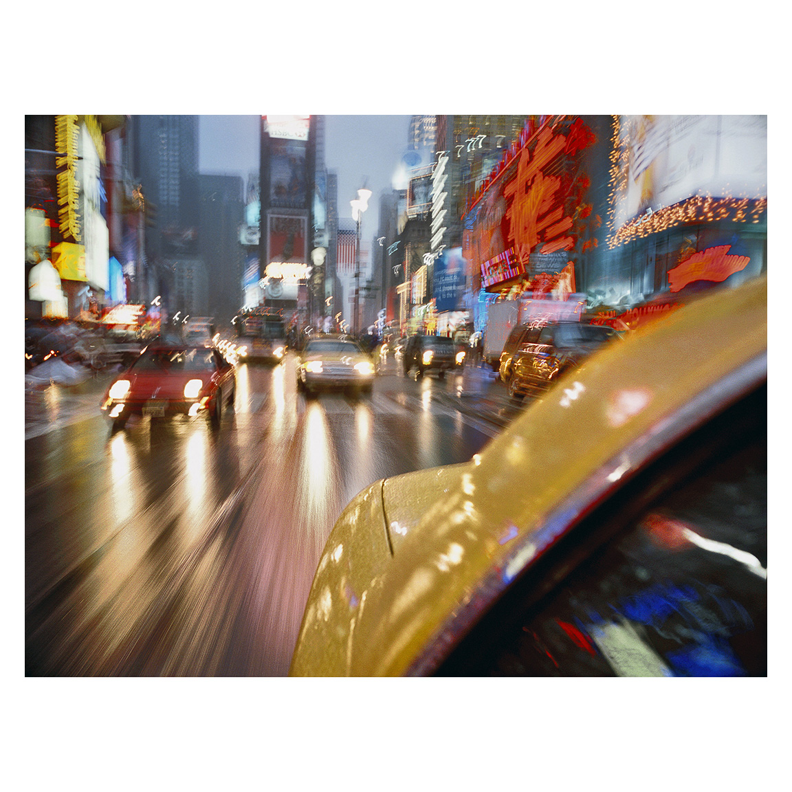 Taxi in Time Square by Lynn Saville